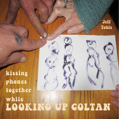 Kissing Phones Together While Looking Up Coltan